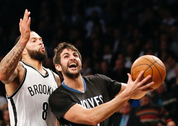 Ricky Rubio goes for the basket.