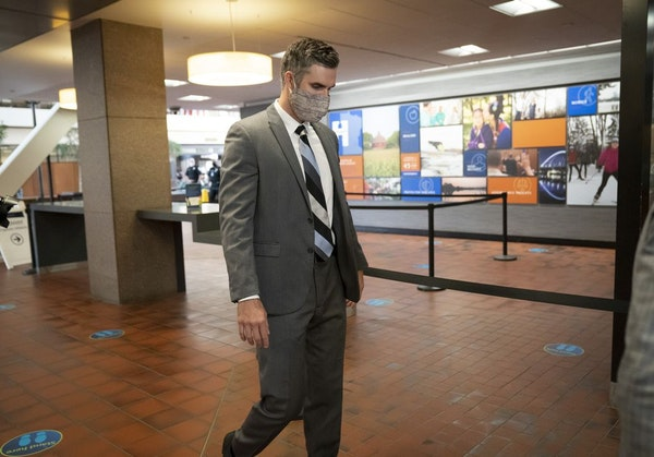 Former police officer Thomas Lane walks through security as he arrived for a hearing at the Hennepin County Government Center in Minneapolis on July 2