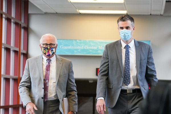 Former Minneapolis police officer Thomas Lane, right, entered the Hennepin County Public Safety Facility with his attorney Earl Gray, left, for a June