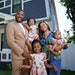 Jovonta Patton and his wife, Symone, are pictured with daughters Ella, 5, Zoey, 3, and baby Cali in front of the new home they purchased a few months