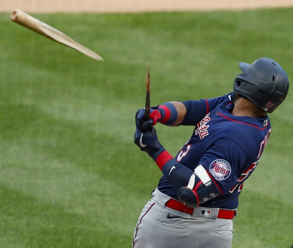 Batter up! … and down The Twins' Nelson Cruz, above, paid for a recent single with a broken bat. Ehire Adrianza, left, wasn't as fortunate. He s