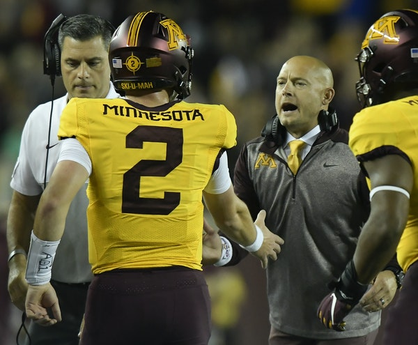 Coach P.J. Fleck and quarterback Tanner Morgan (2) both expected the Gophers to be well-prepared whenever they play next, whether it will be in the sp