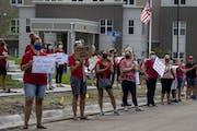In August, Anoka-Hennepin teachers rallied ahead of a school board meeting at Sandburg Education Center in Anoka.