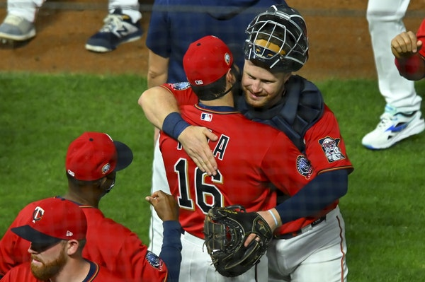Twins catcher Ryan Jeffers was greeted by teammates and coaches, including fellow catcher Alex Avila (16), after Jeffers' big league debut which inclu
