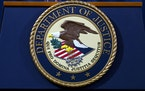 FILE - In this Nov. 28, 2018, file photo, the Department of Justice seal is seen in Washington, D.C.