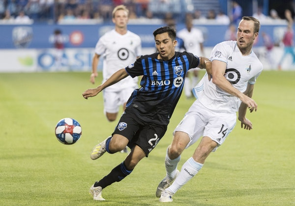 Montreal Impact's Mathieu Choiniere, left, tried to fend off Minnesota United's Brent Kallman in a July 6, 2019 game in Montreal.