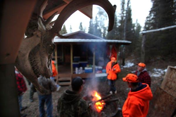 Thirteen deer hunters gathered at this Tower, Minn., deer camp in 2012.