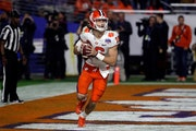 Clemson quarterback Trevor Lawrence, expecting a huge NFL payday, is pushing to play this season.