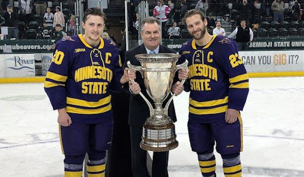 WCHA men's Commissioner Bill Robertson presented the MacNaughton Cup to league champion Minnesota State Mankato.