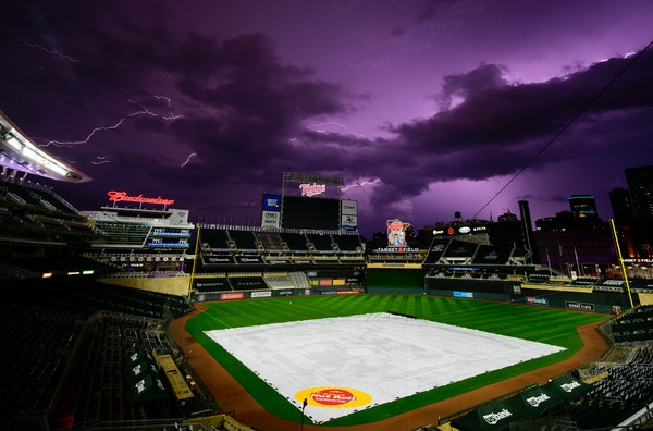 Lightning crackled over Target Field after Friday night's game between the Twins and the Royals was postponed due to weather.