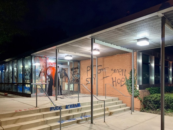 Some of the damage at the Minneapolis Police Department's 5th Precinct headquarters on Saturday night.