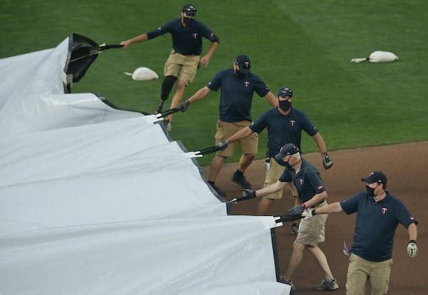 The Minnesota Twins grounds crew pulled the tarp onto the field before Friday night's game postponement was announced. ] aaron.lavinsky@startribune.co