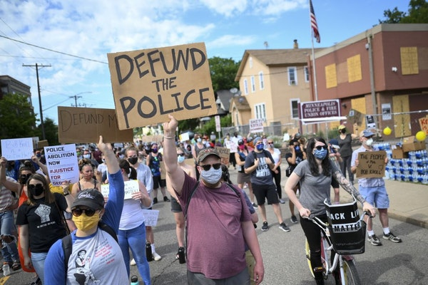 Hundreds of protesters gathered outside the Minneapolis Police Union headquarters in June.
