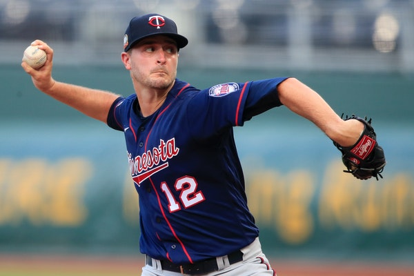 Minnesota Twins starting pitcher Jake Odorizzi delivers to a Kansas City Royals batter during the first inning of a baseball game at Kauffman Stadium