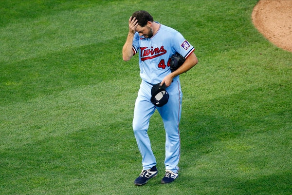 Minnesota Twins starting pitcher Rich Hill heads to the dugout after he was pulled in the third inning of a baseball game against the Milwaukee Brewer