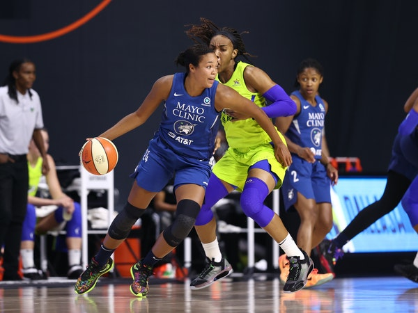 Napheesa Collier of the Lynx handles the ball against Dallas