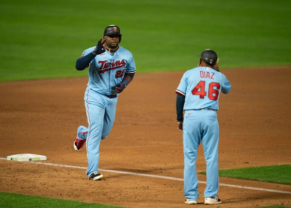 Twins first baseman Miguel Sano celebrated his third inning home run with third base coach Tony Diaz.
