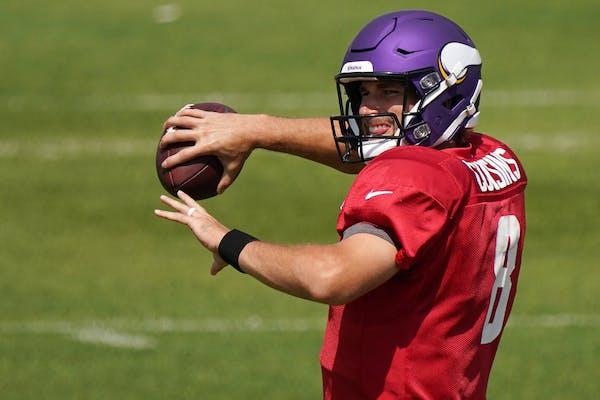 Minnesota Vikings quarterback Kirk Cousins (8) threw during practice Aug. 21.