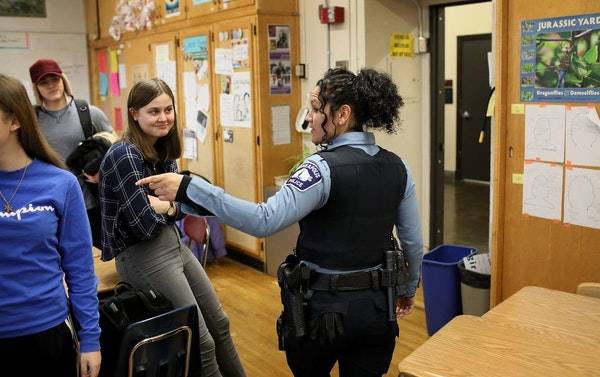 The Minneapolis and St. Paul school districts voted in June to end their contracts with local police departments. Now the debate moves to the suburbs.