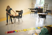 Haley Puckhaber positioned the desks in her fourth-grade classroom at safe distances for incoming students at Friendship Academy for the Arts while ge