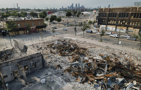 Buildings that were burned during unrest in late May remain a pile of rubble at the intersection of 27th Avenue and Lake Street in south Minneapolis.