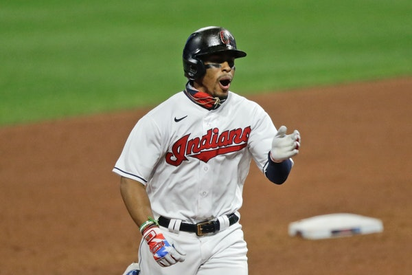 Cleveland's Francisco Lindor reacts as he runs the bases after hitting a two-run home run in the sixth inning i