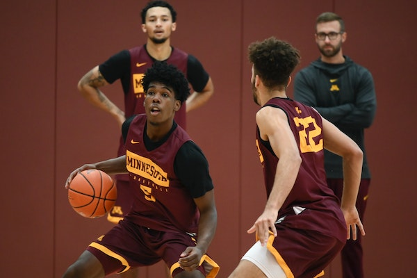 Marcus Carr handled the ball during a 2019 practice as he was defended by Gabe Kalscheur