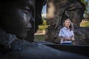"Mary Ceruti, executive director of Walker Art Center, in the Minneapolis Sculpture Garden with Mark Manders' sculpture ""September Room."" Photo b"