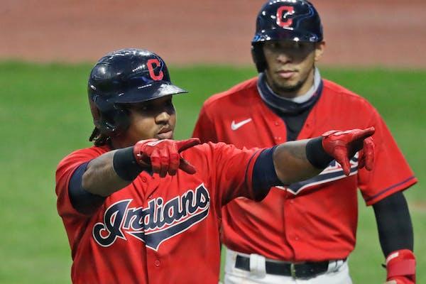 Cleveland's Jose Ramirez celebrates after hitting a three-run home run in the third inning