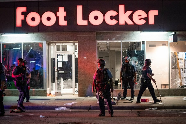 Crowds clashed with police, smashed windows and looting occurred in downtown Minneapolis on Wednesday night.