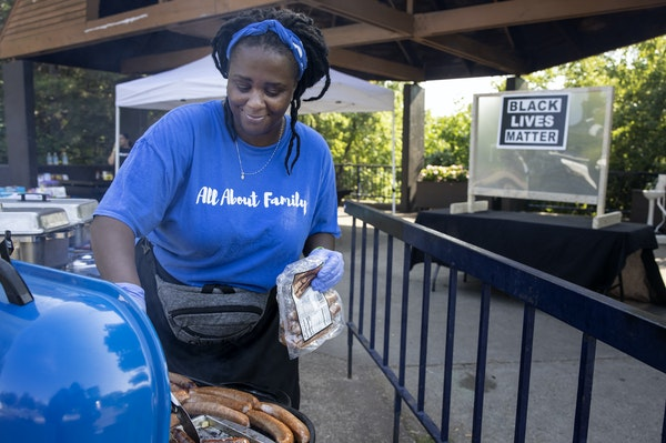 Tasheka James, owner of Chubby's Catering, prepared food at the Black Entrepreneur State Fair at Father Hennepin Bluff Park in Minneapolis.