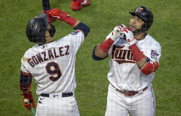 Nelson Cruz celebrated with Twins teammate Marwin Gonzalez after homering at Target Field on Aug. 17.