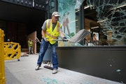 Crews worked Thursday to clean up glass and board up the broken windows at the Nordstrom Rack on Nicollet Mall.