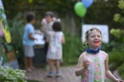 """Frankie Rockwell, 4, enjoyed a snow cone on opening day of Jennifer Debrow's """"State Fair at Home"""" on Thursday. Debrow created a mini fair for ne"""