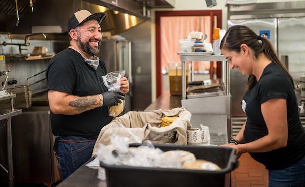 Chef Gustavo Romero in the kitchen of Nixta, with Kate Kiernoziak, his business partner and spouse.