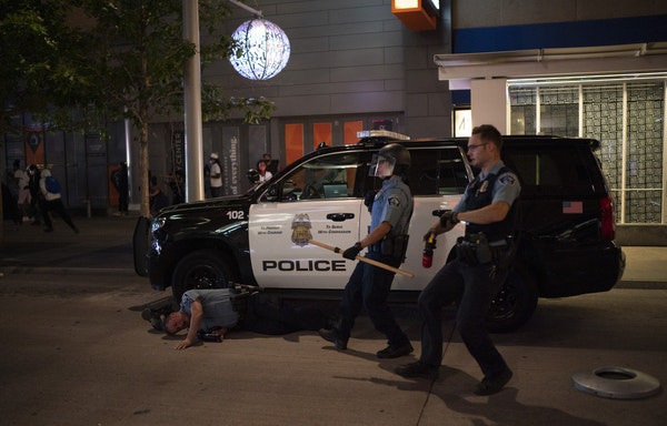 A Minneapolis police officer injured in August's unrest in downtown Minneapolis.