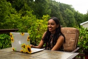 Tanisha Kota, 15, checked in on another student tutor over a video chat at her home in Eagan.