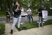 Ashley Quinones protested at Hennepin County Attorney Mike Freeman's home. Her husband, Brian, was killed by police in 2019.