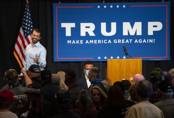 Donald Trump Jr. smiled and gave a thumbs up to supporters at the conclusion of his campaign event at the DECC in Duluth on Wednesday.