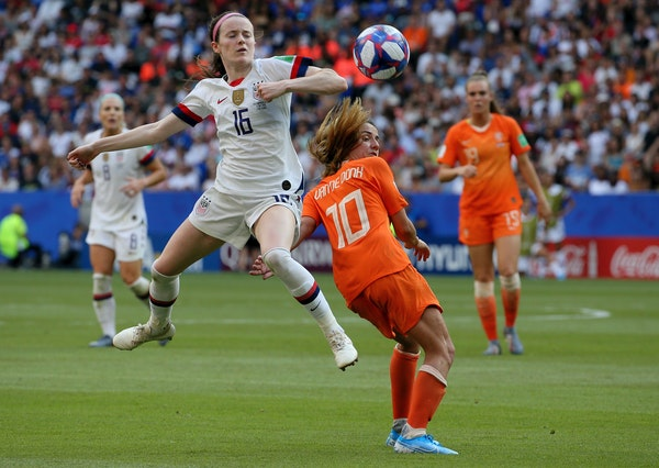 United States' Rose Lavelle, left, is challenged by Netherlands' Danielle Van De Donk during the Women's World Cup final soccer match between US and T