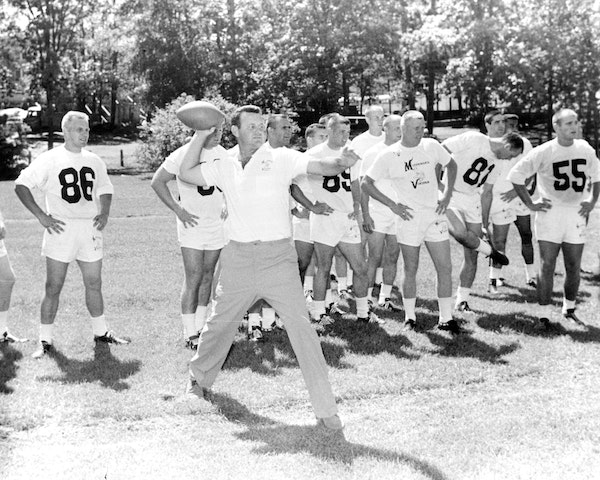 Coach Norm Van Brocklin showed off his throwing arm as the Vikings gathered for their first training camp in Bemidji, Minn., in July of 1961.
