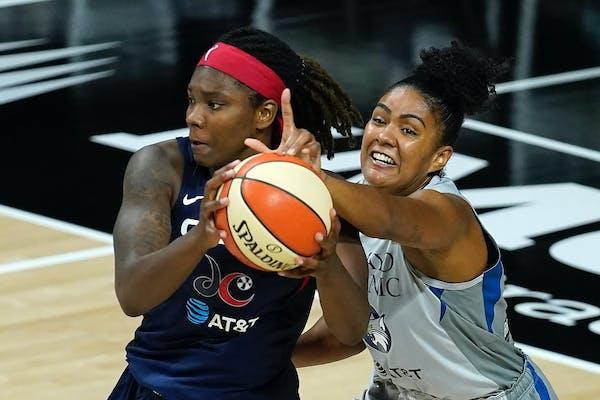 Lynx forward Damiris Dantas, right, tries to stop Washington Mystics forward Myisha Hines-Allen during the second half