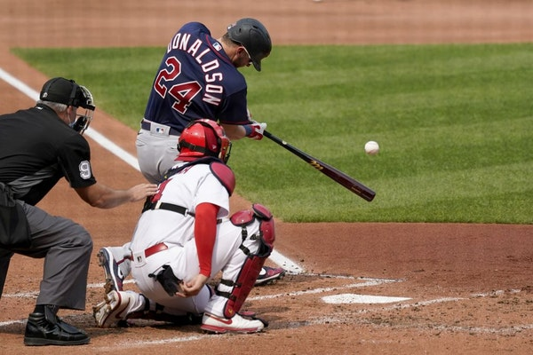 Minnesota Twins' Josh Donaldson (24) hits a three-run home run during the third inning in the first game of a baseball doubleheader against the St. Lo