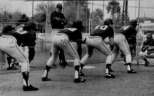 Lou Brock worked with some Twins players during 1986 spring training. The players (right to left) were Kirby Puckett, Billy Beane, Ron Washington and