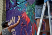 Renowned local artist Leslie Barlow and a crew painted a mural on the boarded up front of Fall Out Arts Initiative in the wake of the death of George