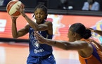 Minnesota Lynx guard Crystal Dangerfield (2) passes off in front of Phoenix Mercury center Kia Vaughn (1) during the second half of a WNBA playoff bas