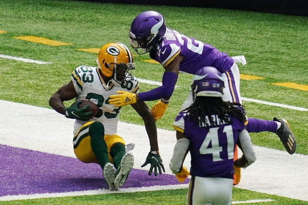 Green Bay Packers receiver Marquez Valdes-Scantling (83) caught a touchdown pass while being defended by Vikings rookie defensive back Cameron Dantzle