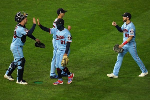 Minnesota Twins left fielder Eddie Rosario (20) celebrated Saturday's win with Minnesota Twins catcher Ryan Jeffers (39).