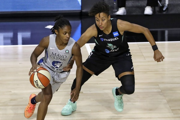 Lynx guard Crystal Dangerfield, left, moves around New York Liberty guard Layshia Clarendon during a game last month.