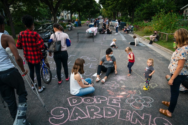 Families gathered Tuesday and decorated the street with chalk art, including writing what they love about their block, during National Night Out on S.